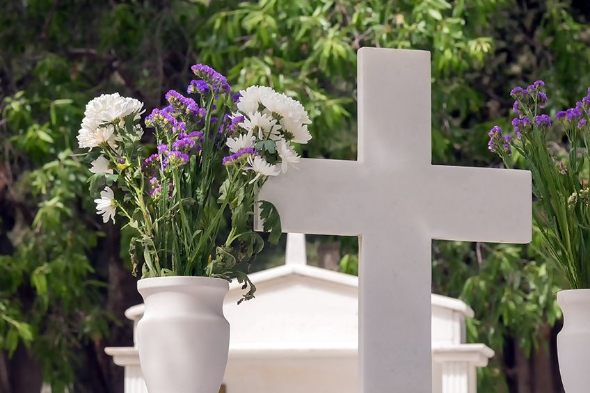 How can a church or synagogue purchase burial space for their members?